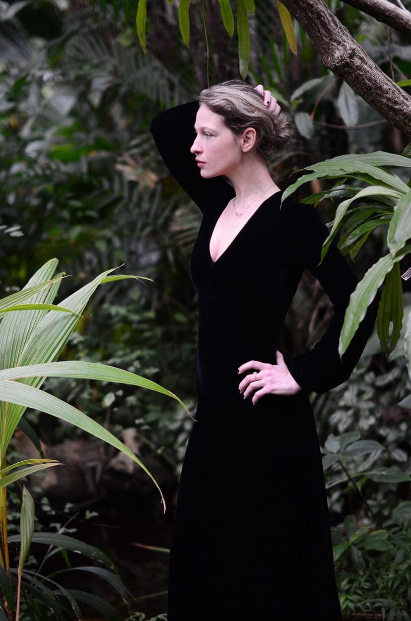 Wearing a black velvet evening gown at the botanical garden ...