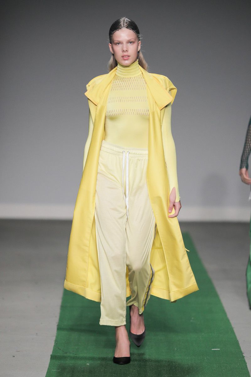 M.E.N. showing at the Mercedes-Benz Amsterdam Fashion Week - yellow coat