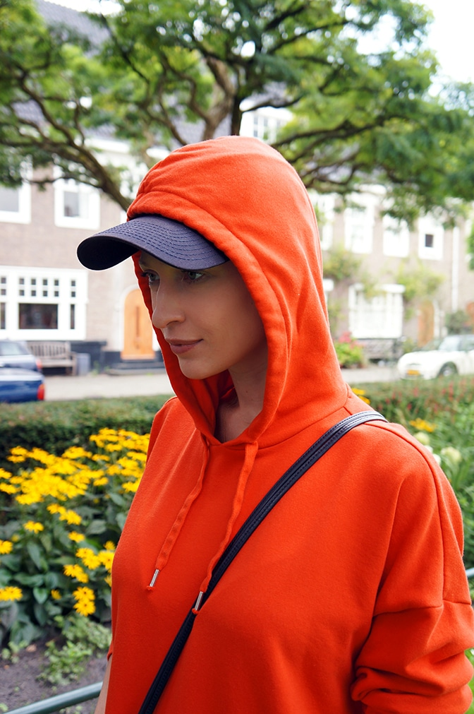 an orange sweatshirt dress with a hoodie